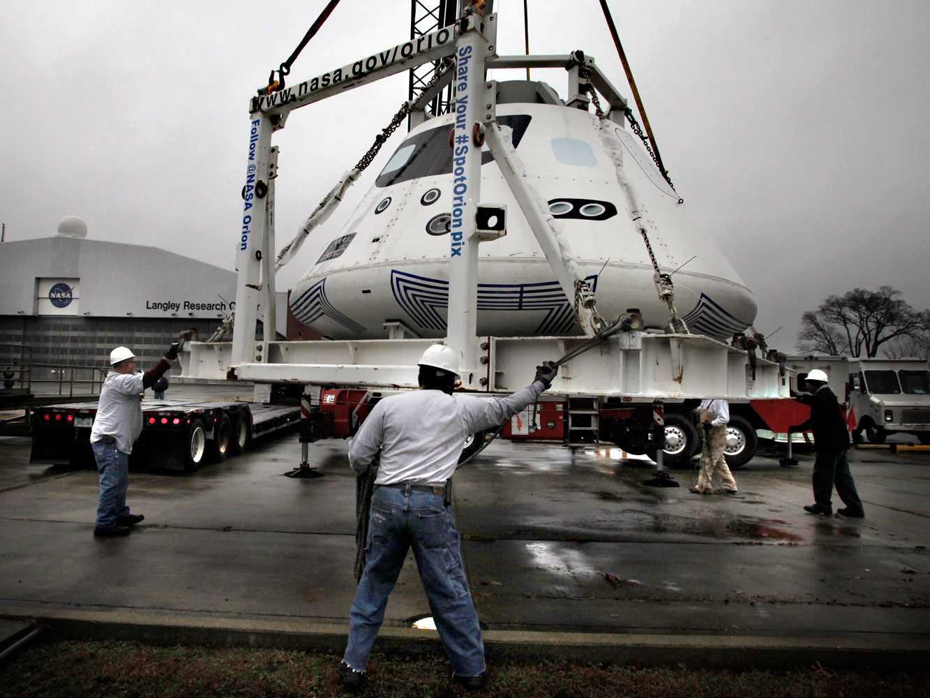 This Orion boilerplate—essentially a dead weight mock-up—is loaded on a flatbed trailer for shipment to San Diego, where it is used to rehearse water recovery in the run-up to the 2014 test launch.