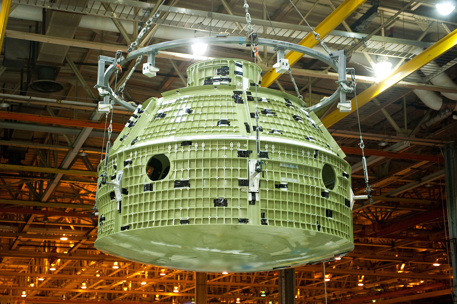 The NASA team at the Michoud Assembly Facility in New Orleans has completed the final weld on the first space-bound Orion capsule, on June 22, 2012. The crew compartment is within this structure, which is then enclosed in the conical exterior.
