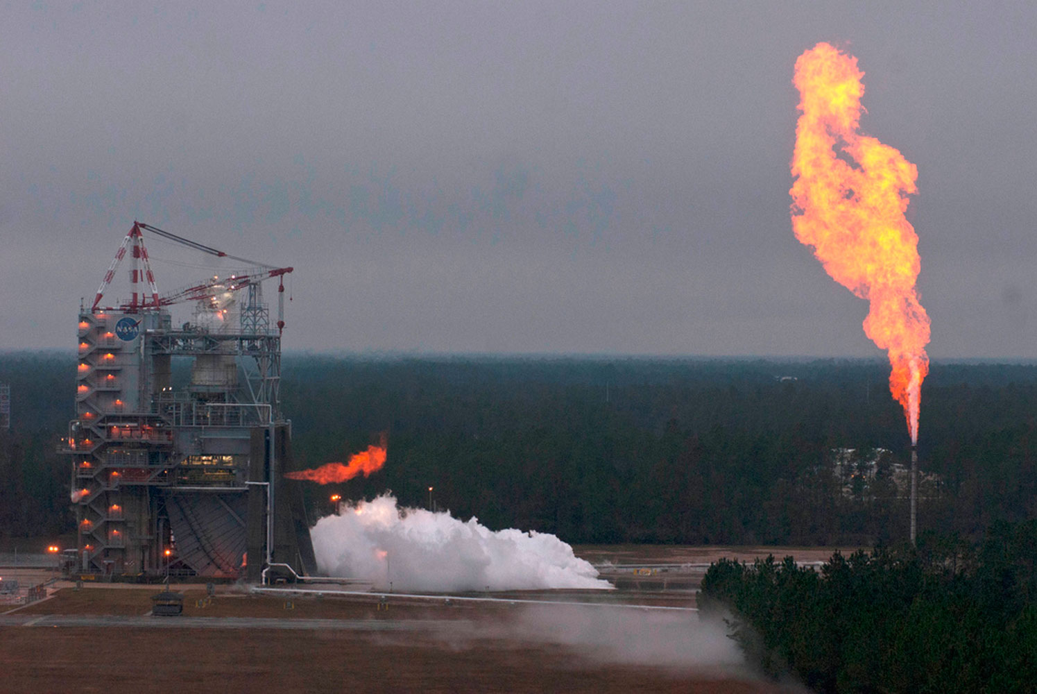 A version of the J-2X engine burns brightly during a 278-sec. hot fire test Nov. 27, 2012 at NASA's Stennis Space Center in Mississippi. The J-2X will power the upper stage of of the SLS.