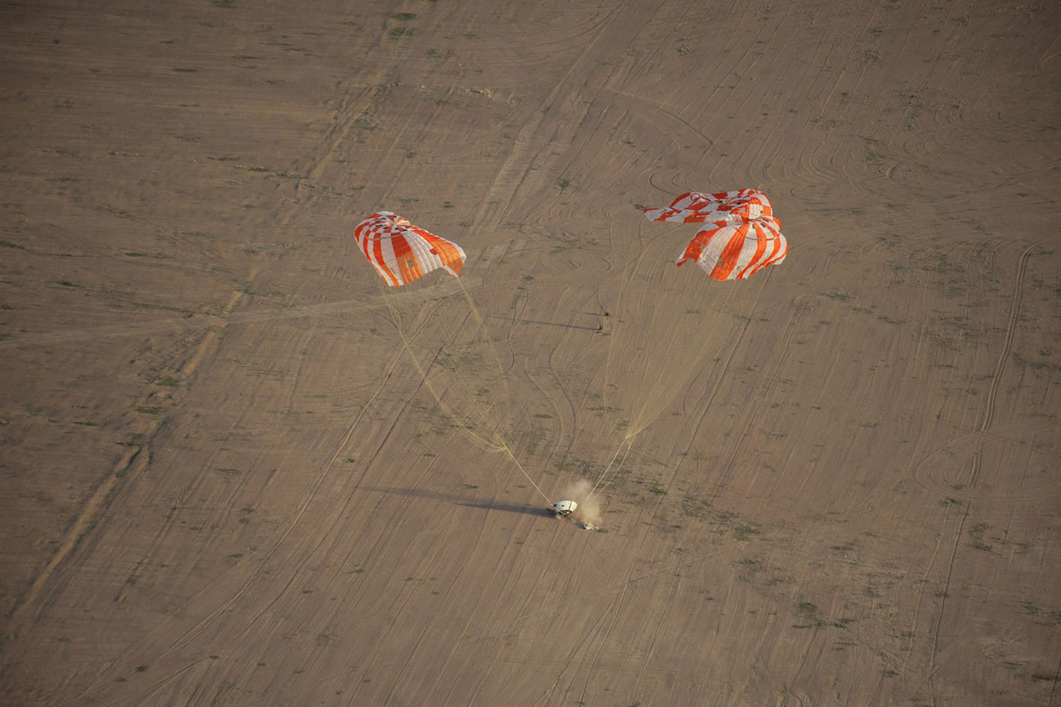 A test model of the Orion spacecraft with its parachutes was dropped high above the the Arizona desert on Feb. 29, 2012. This particular drop test—the latest of a series—studied the stability of the wake left by the Orion as it descended.