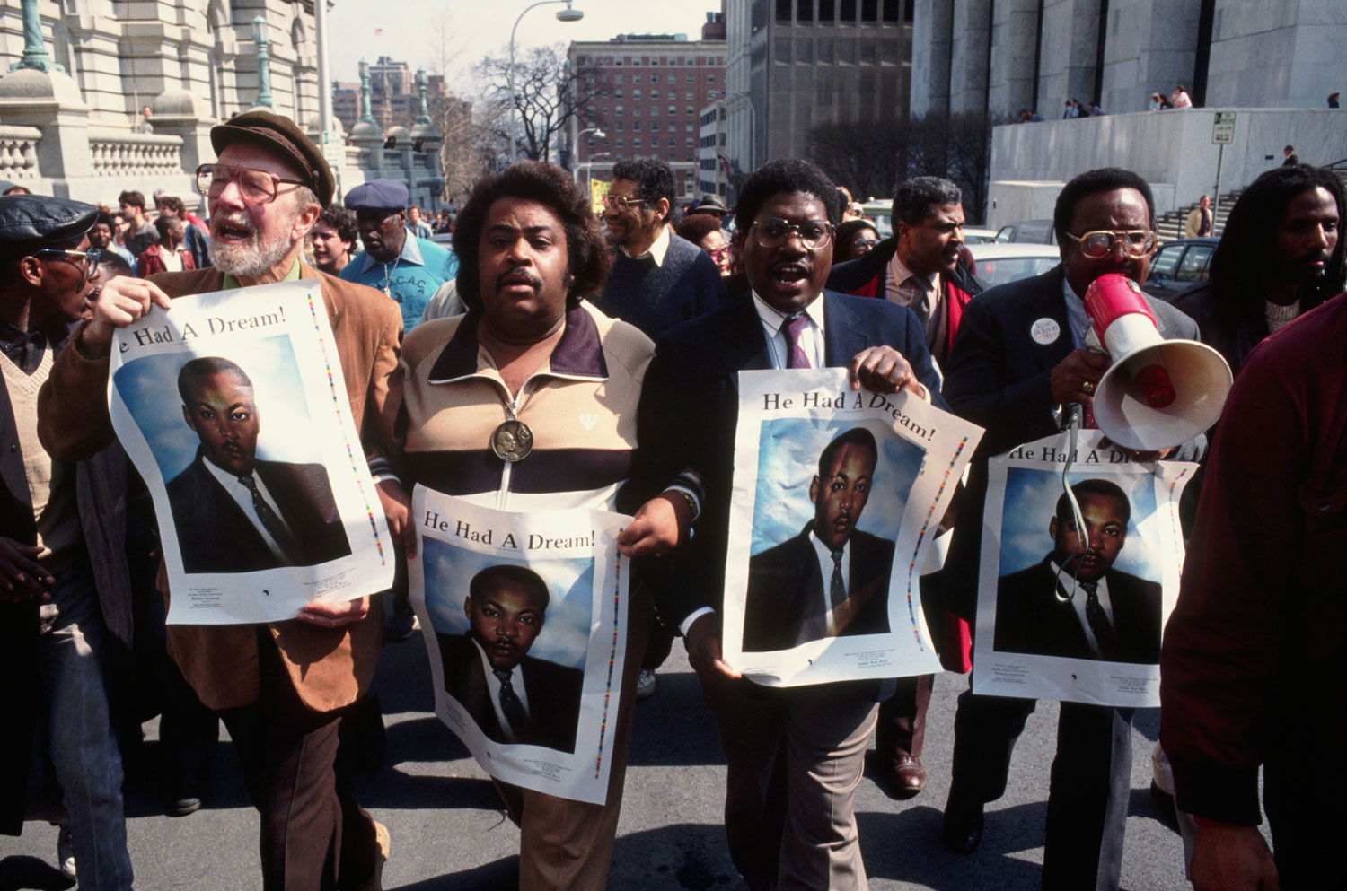 From left: Pete Seeger, Al Sharpton and other civil rights activists lead a demonstration in protest of the Tawana Brawley incident, in Albany, N.Y., in March 1988.