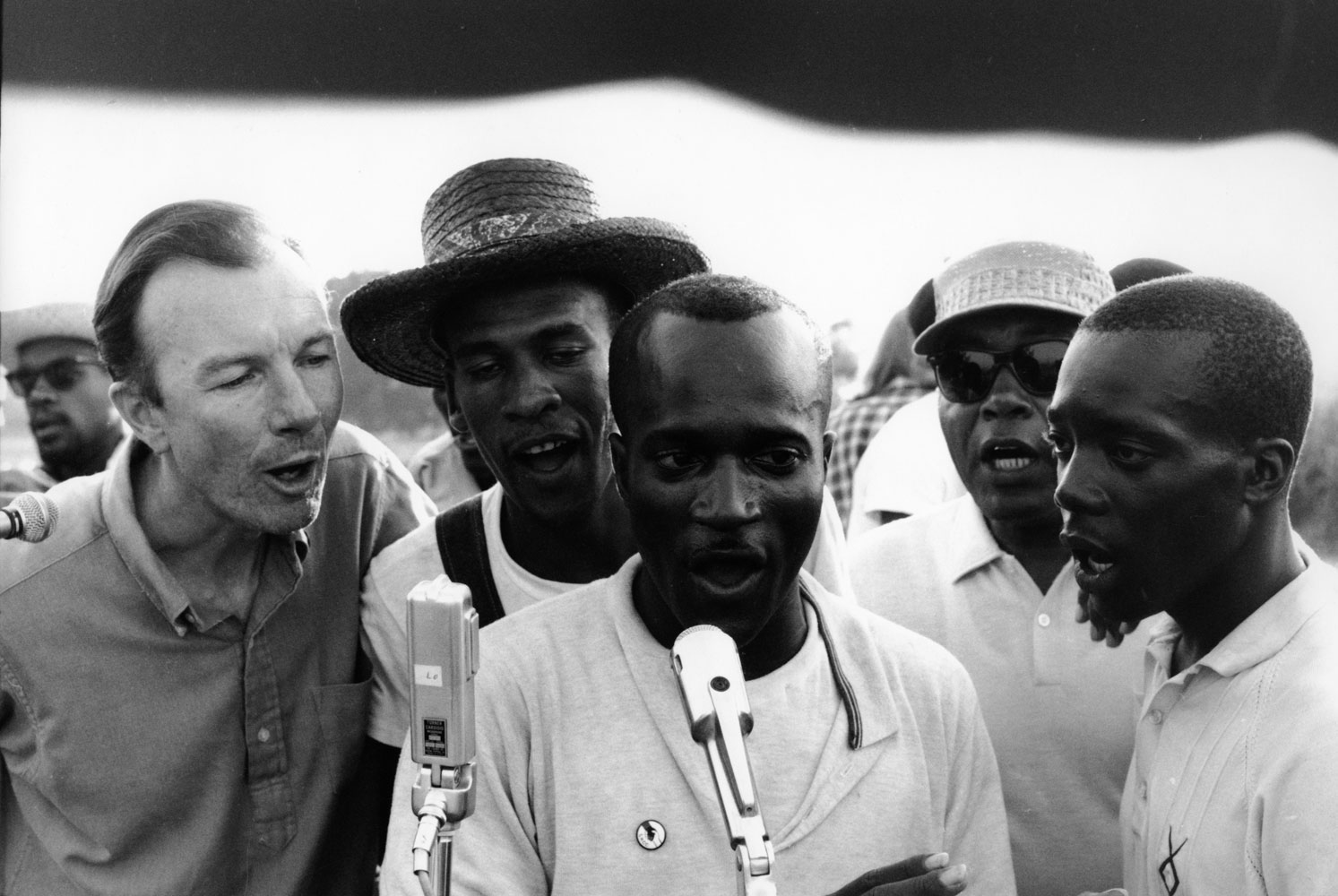 American folksinger and activist Pete Seeger sings with fellow activists at a Student Nonviolent Coordinating Committee (SNCC) rally, in Greenwood, Miss., in 1963.