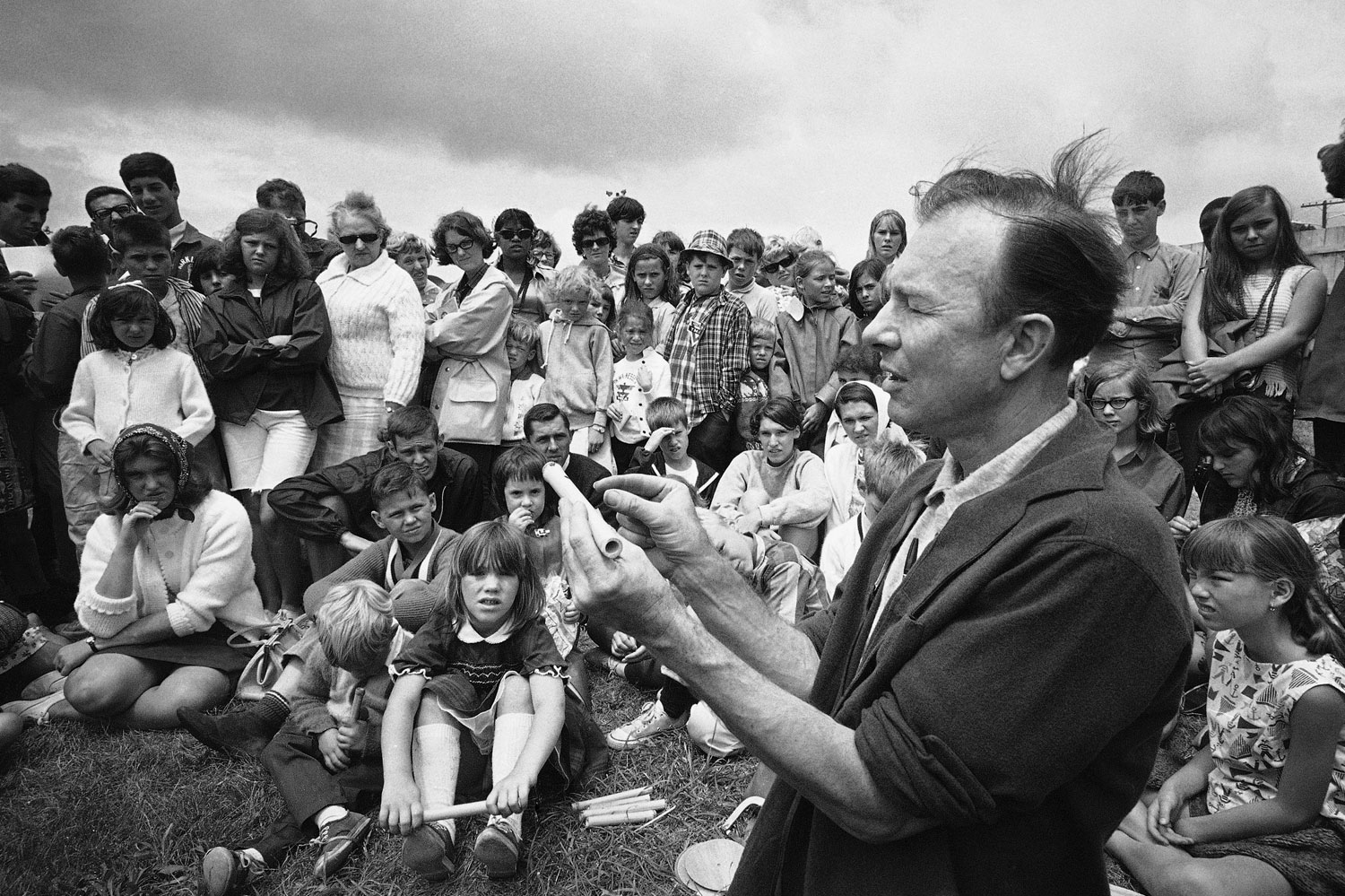 Pete Seeger conducts an instrument making session on Children's Day at the Newport, R.I., Folk Festival on July 20, 1966.
