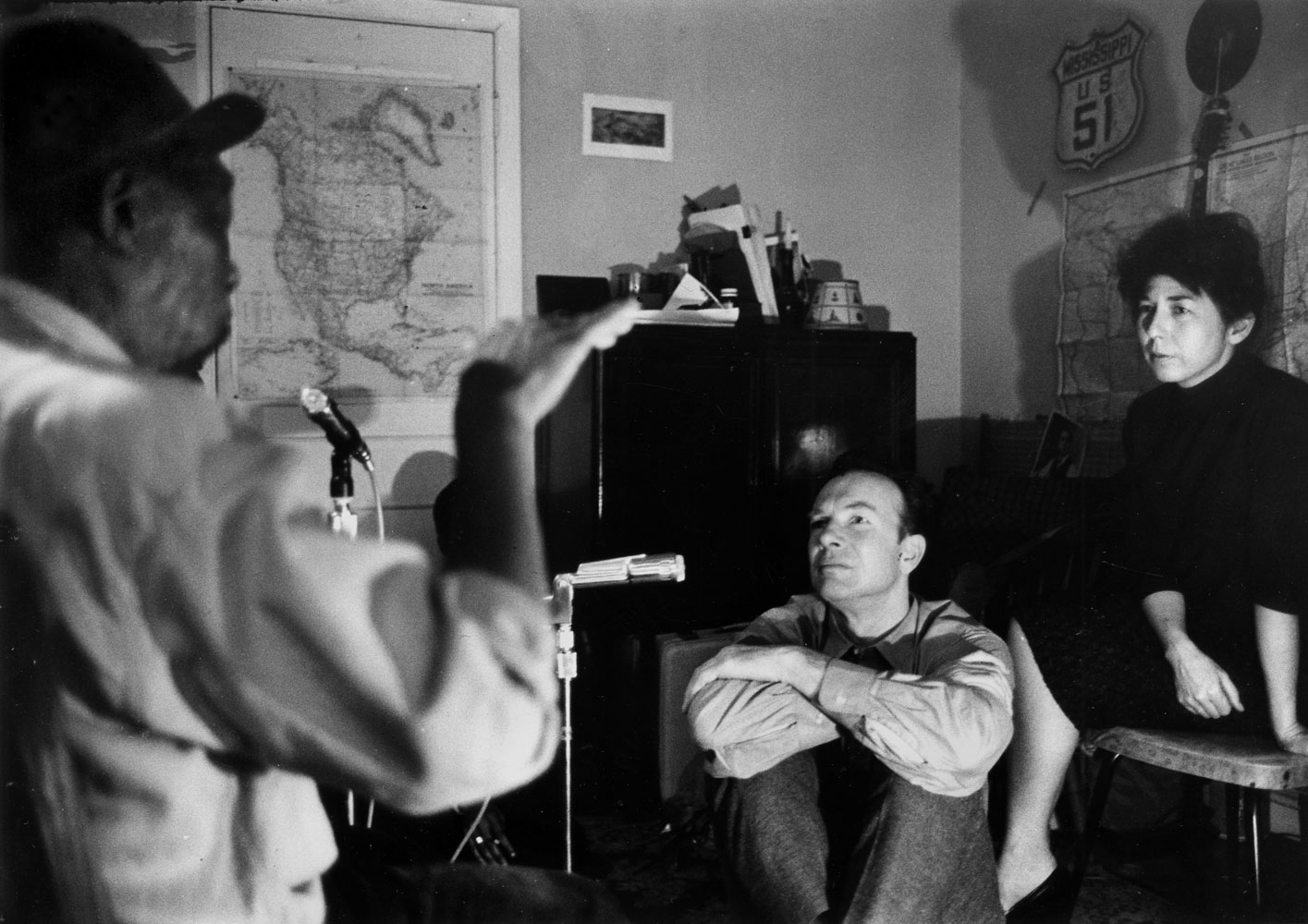 Pete Seeger (center) and his Toshi sit during a recording session with John Hurt, c. 1960s.