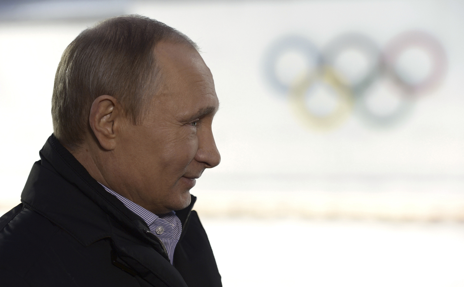 Russian President Vladimir Putin listens to a journalist's question during a televised news conference in Sochi January 19, 2014.
