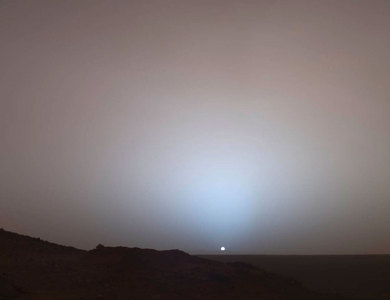 The Mars Rover Spirit took this sublime view of a sunset over the rim of Gusev Crater, about 80 kilometers (50 miles) away.