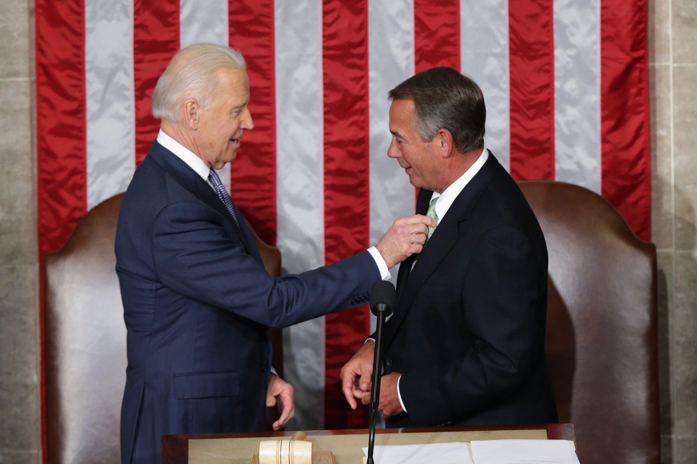 Vice President Joe Biden fixes House Speaker John Boehner's tie.