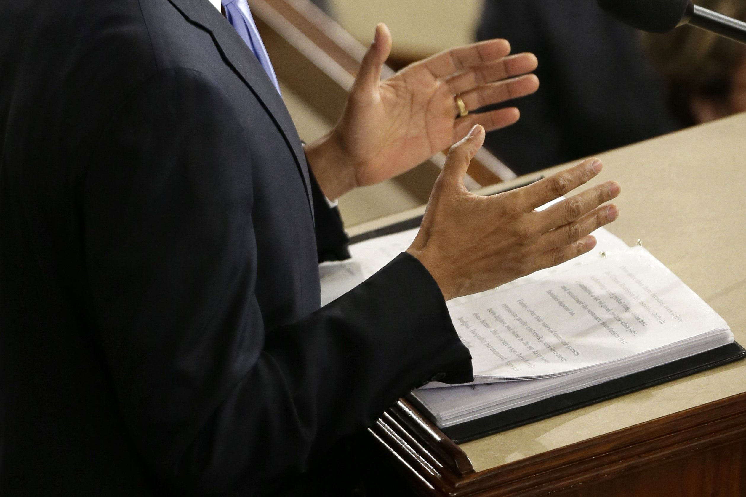 President Barack Obama gestures as he delivers his State of the Union address.
