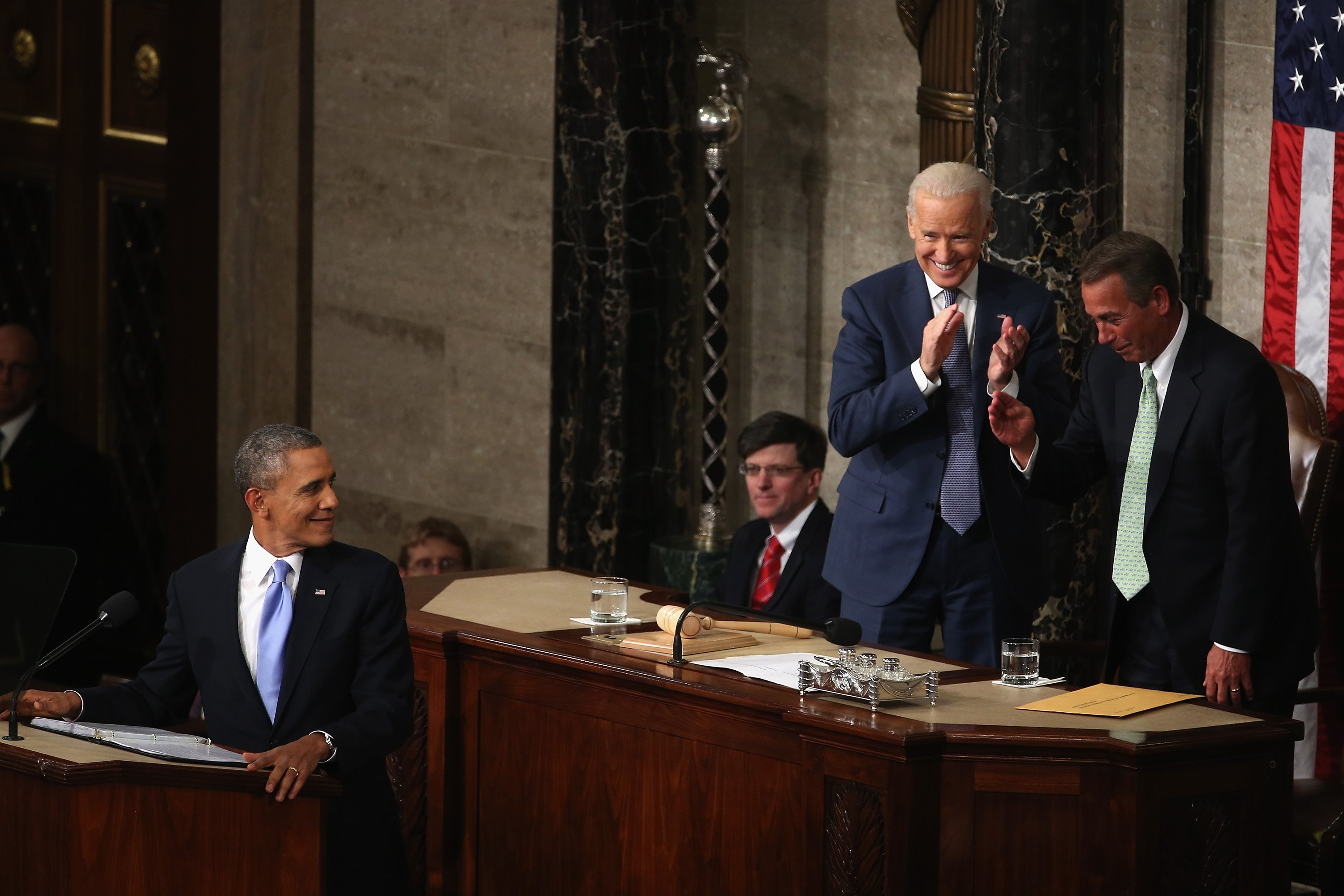 President Barack Obama turns to acknowledge House Speaker John Boehner after referencing his father in the opening of his address.