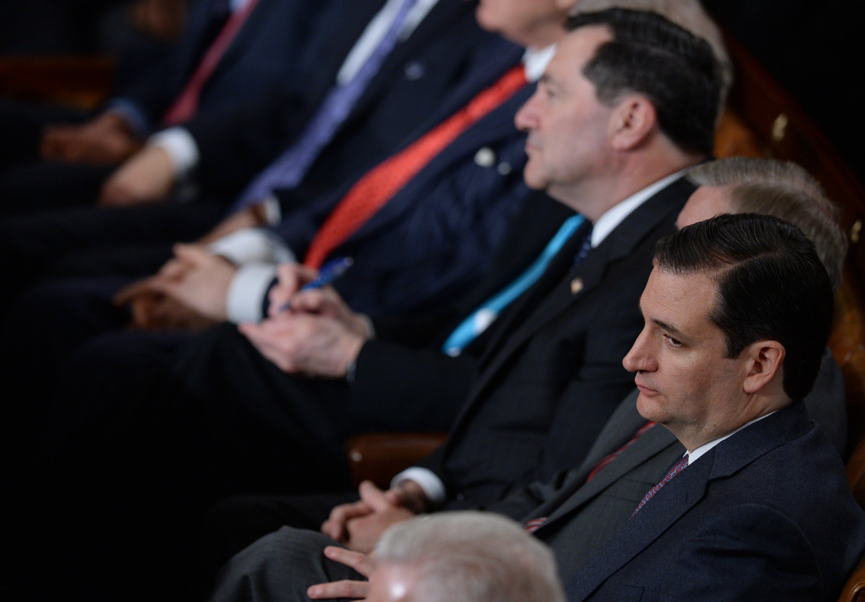 Republican Senator from Texas Ted Cruz listens to President Barack Obama deliver the State of the Union address.