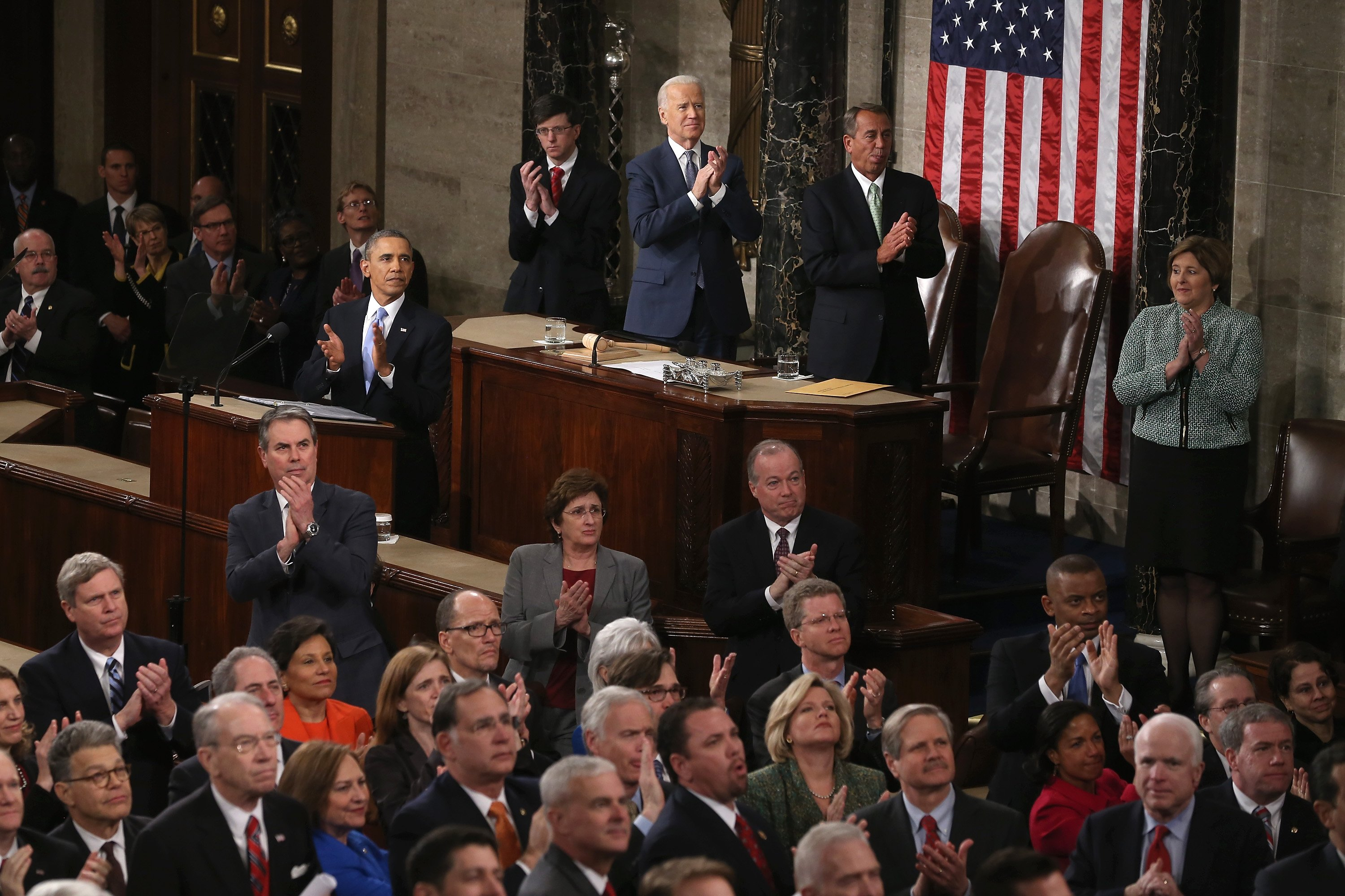The chamber stands to applaud for U.S. Army Ranger Sgt. First Class Cory Remsburg as he is acknowledged in President Barack Obama's address.