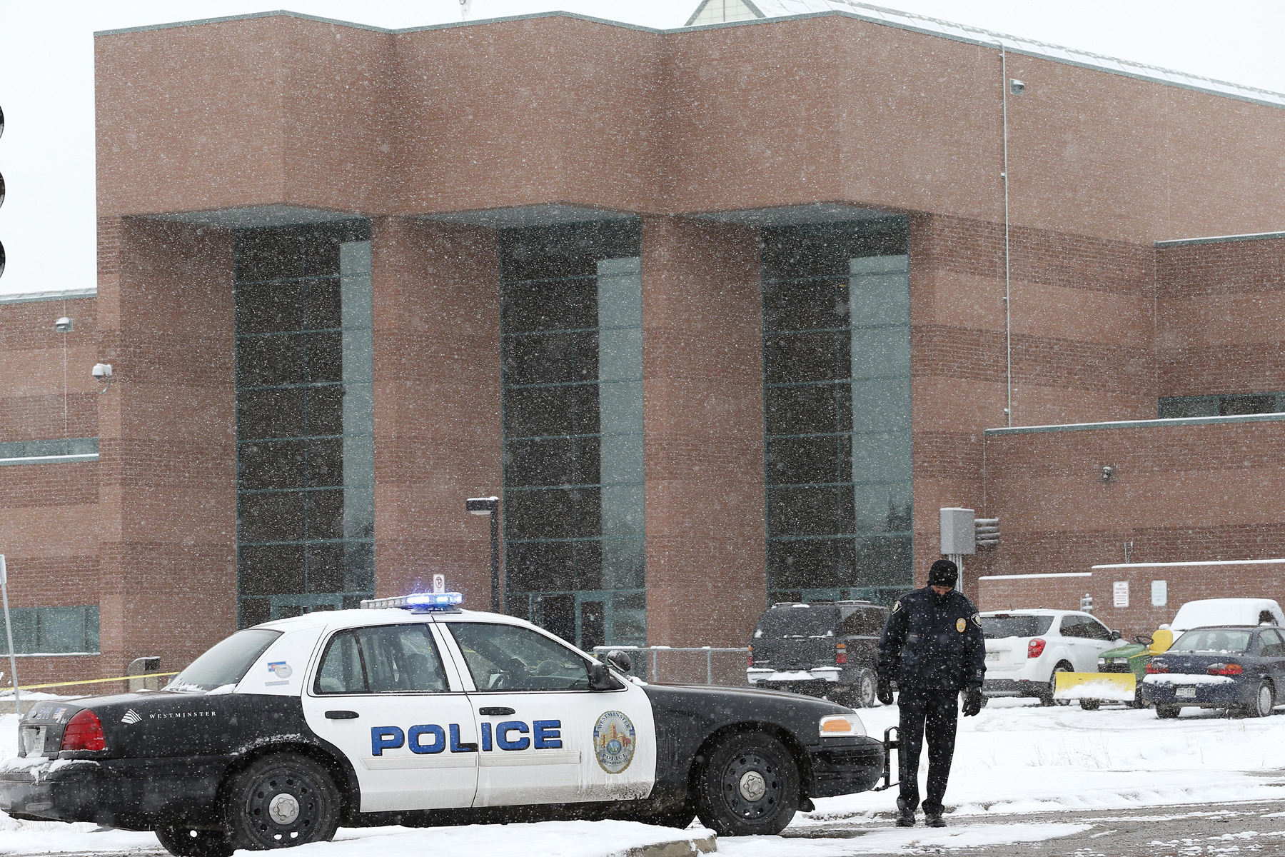 A police cruiser blocks the entrance to Standley Lake HIgh School after an apparent suicide attempt by a student, in Westminster, Colo., Monday, Jan. 27, 2014.