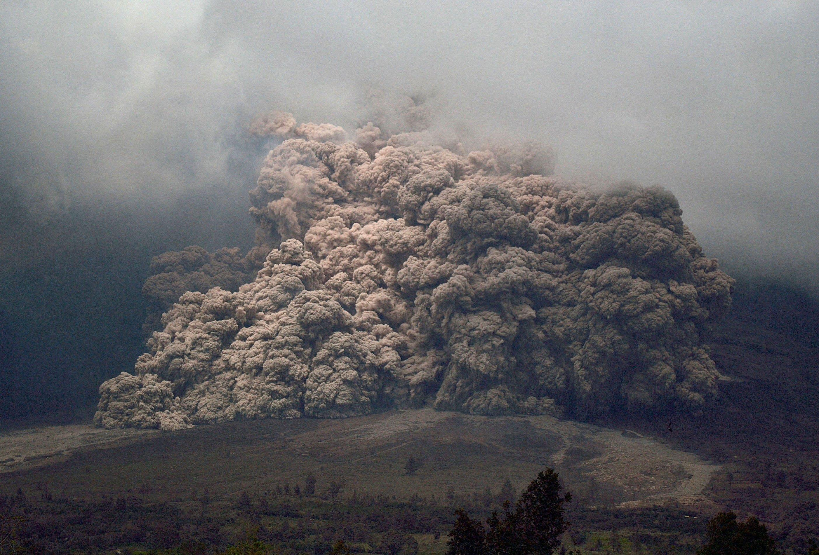 Sinabung mount spews ash to the air during an eruption near Karo, North Sumatra, Indonesia, Jan. 7, 2014.