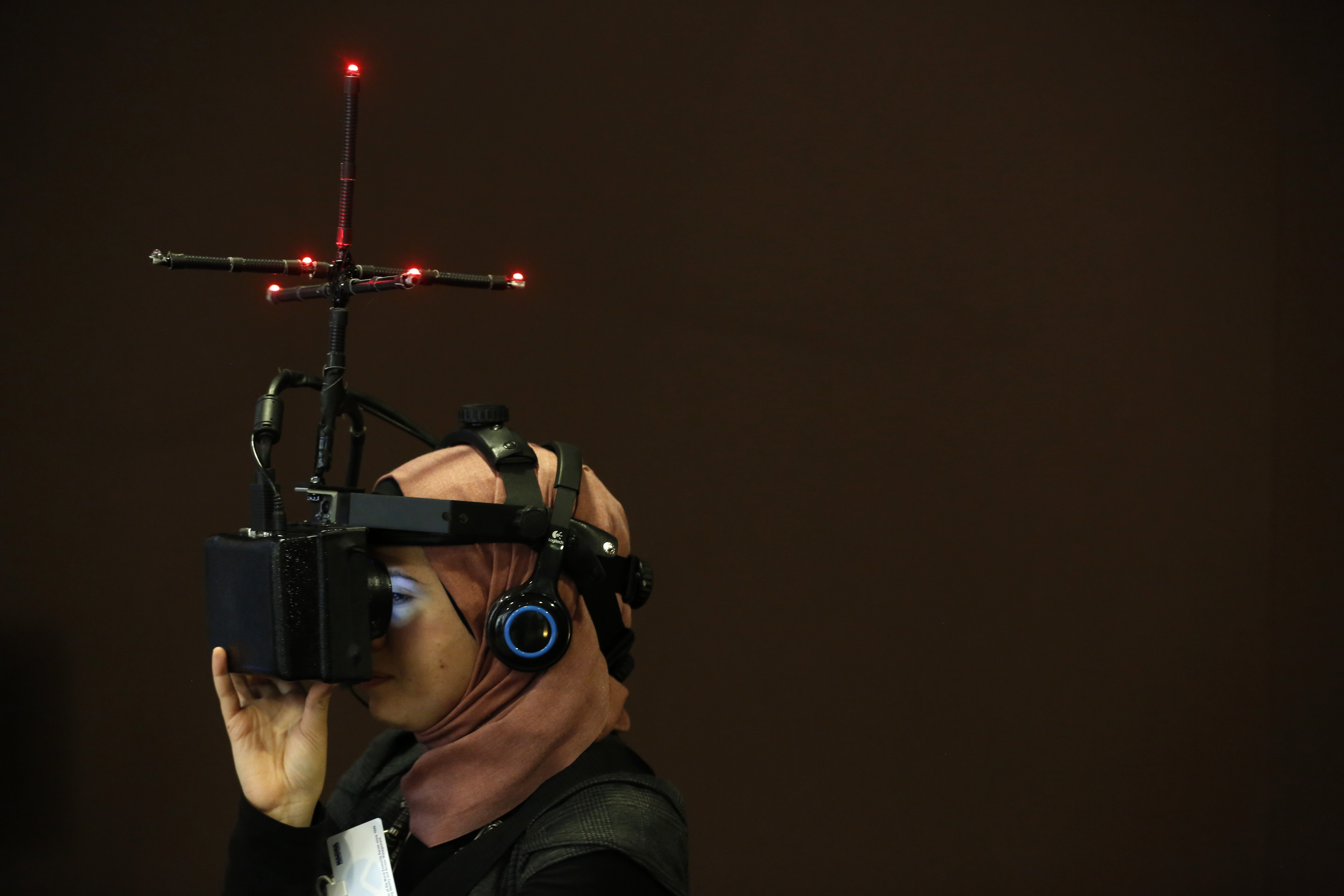 An attendee watches a virtual presentation of a bomb explosion in Syria, using a head-mounted visual display, on the opening day of the World Economic Forum (WEF) in Davos, Switzerland, Jan. 22, 2014.