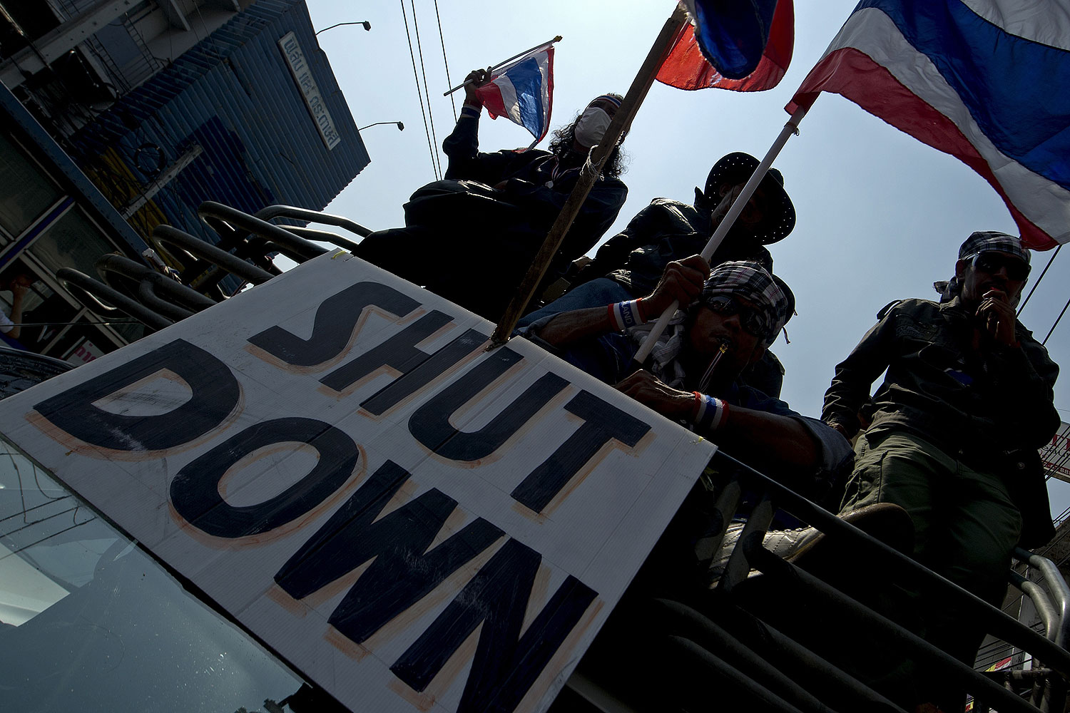 Thai anti-government protesters wave national flags as they parade during a rally in Bangkok on Jan. 24, 2014