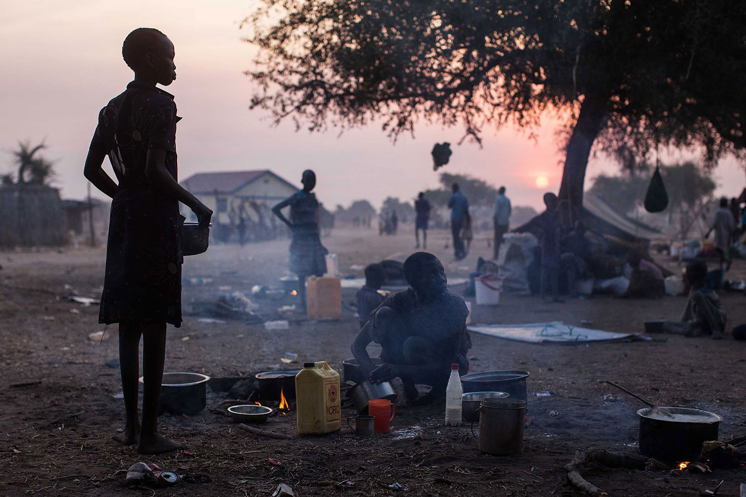 Jan. 8, 2014. People go about their daily life in Minkammen, 16 miles south of Bor, South Sudan.