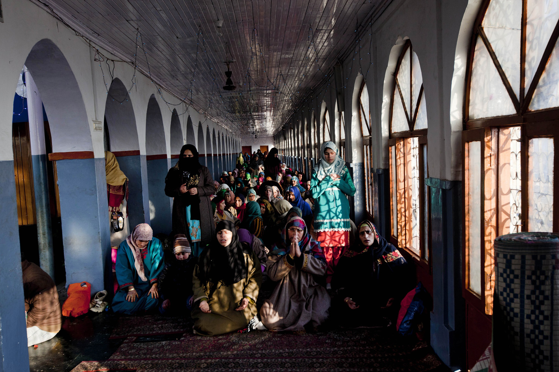 Dec. 27, 2013. Kashmiri Muslim women pray inside the shrine of Sufi saint Hazrat Sheikh Hamza Makhdoom, commonly known as Sultan-Ul-Arifeen, on the eve of the saint's Urs, in Srinagar, India.