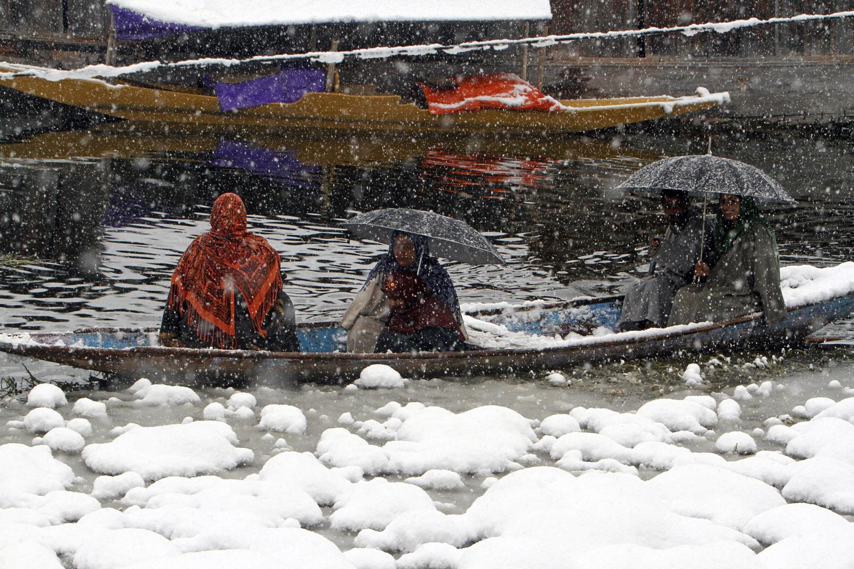 Dec. 31, 2013. A Kashmiri family crosses Dal Lake in a Shikara (gondola) in Srinagar, the summer capital of Indian Kashmir.