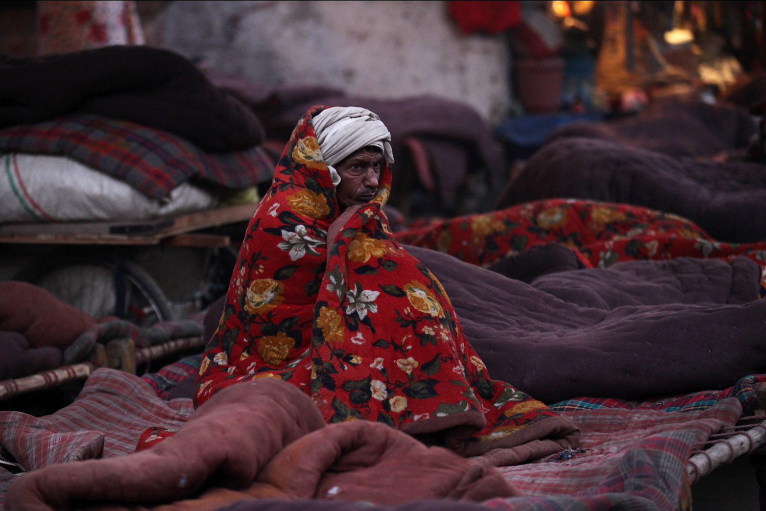 Jan. 2, 2014. An Indian daily worker is seen in an open area during a cold winter morning at the old quarters of Delhi, India.