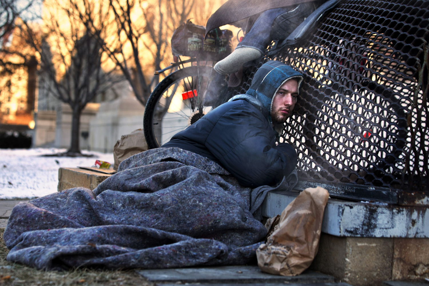 Jan. 4, 2014. Nicholas Simmons, 20, of Greece, N.Y.,  warms himself on a steam grate with three homeless men by the Federal Trade Commission, just blocks from the Capitol, during frigid temperatures in Washington.