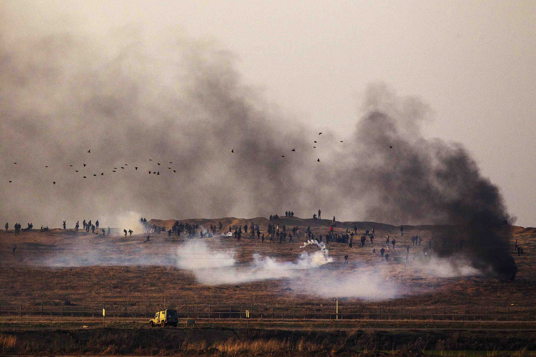 Dec. 27, 2013. Palestinian demonstrators protest near the Israeli border fence with Gaza as Israeli army shoots tear gas.