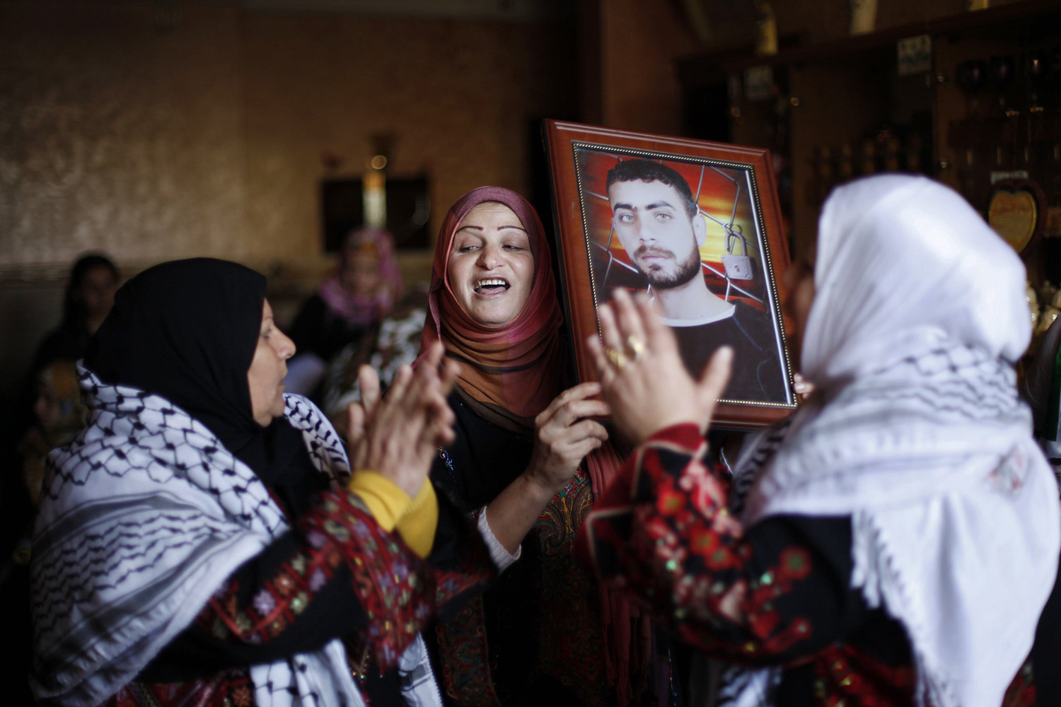 Dec. 30, 2013. Relatives of Palestinian prisoner Rami Barbakh, who has been held by Israel since 1994, celebrate ahead of his expected release in Khan Younis, in the southern Gaza Strip.
