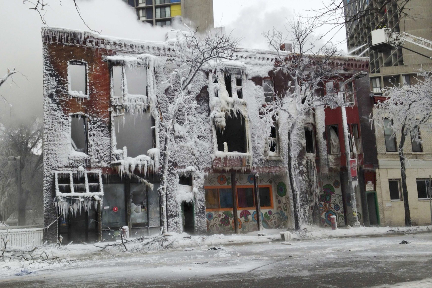 Jan. 1, 2014. Ice covers an apartment building which was destroyed by an explosion and a fire in Minneapolis.