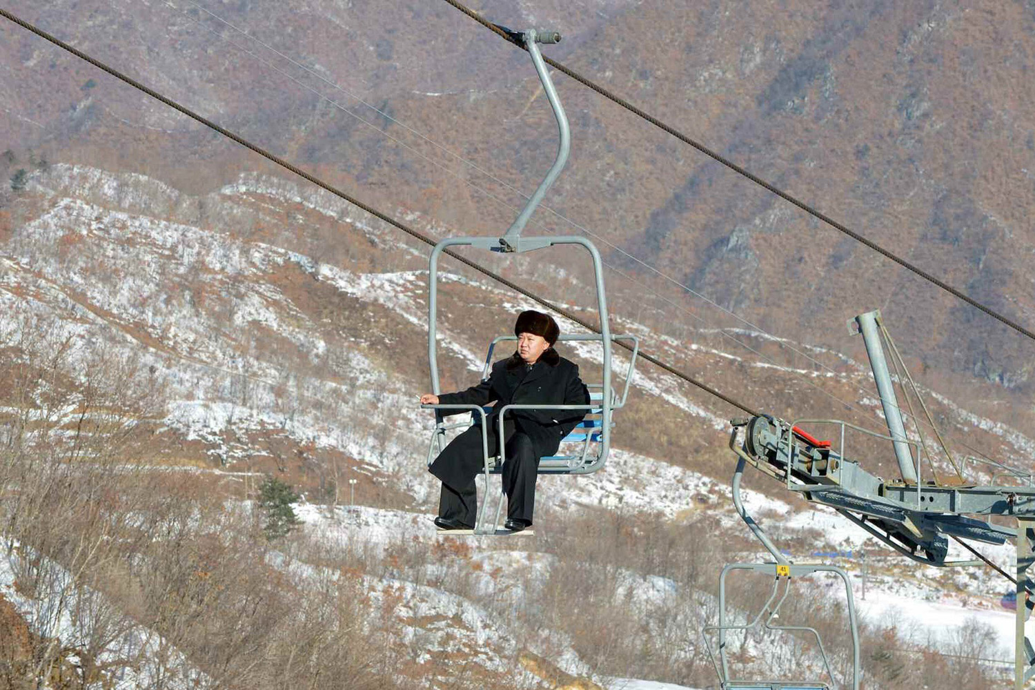 North Korean leader Kim Jong Un sits on a ski lift during a visit to a newly built ski resort in the Masik Pass region, in this undated picture published in the North Korean newspaper Rodong Sinmun, and released by Yonhap on Dec. 31, 2013.