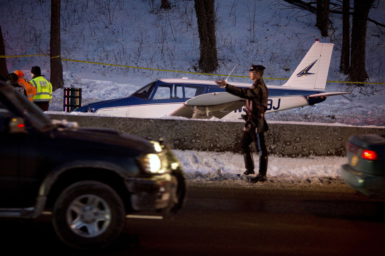Jan. 4, 2014. A single engine plane is seen amid vehicle traffic on the Major Deegan Expressway in the Bronx borough of New York.
