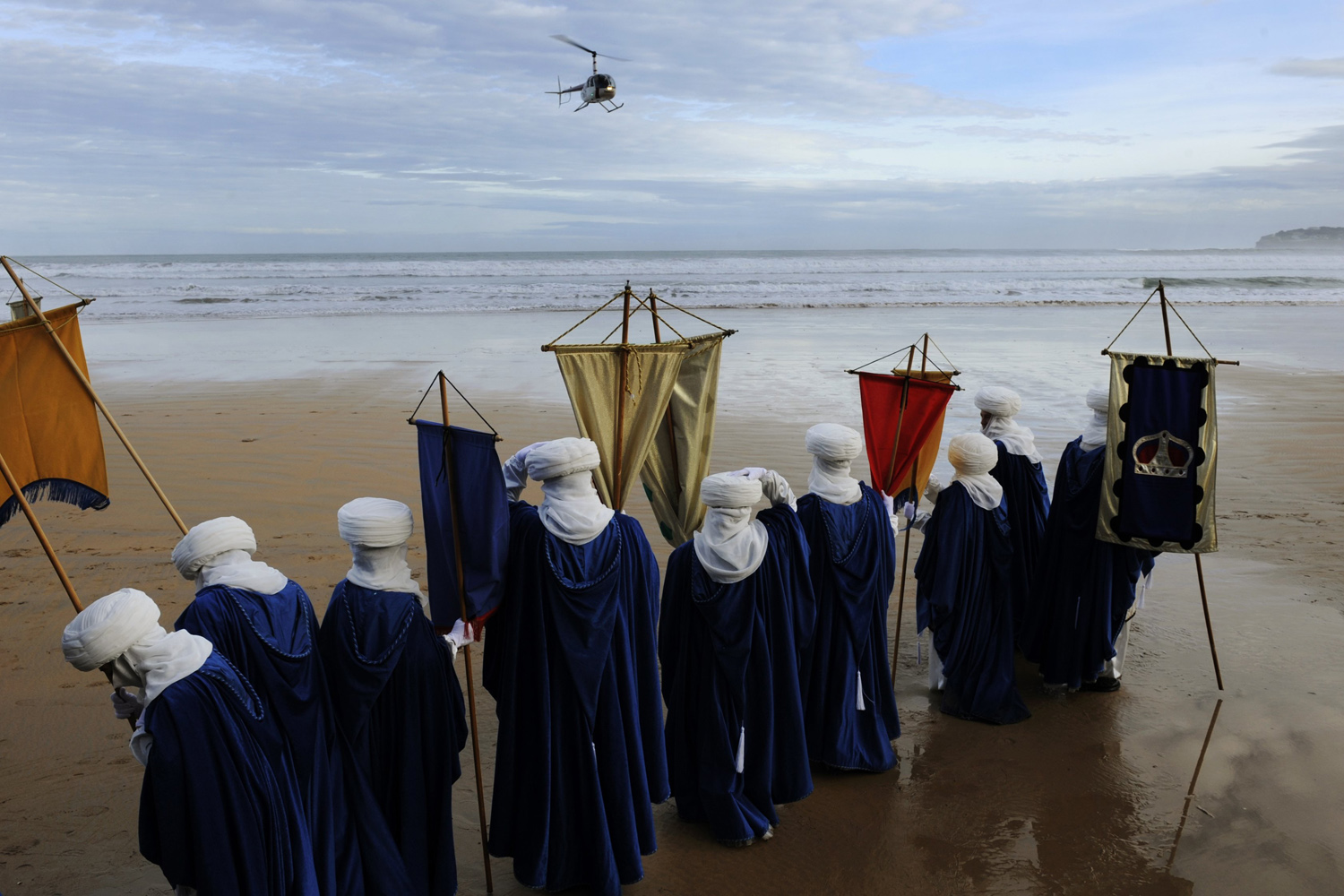 Jan. 5, 2014. People role playing as members of the royal entourage await the arrival of the Three Wise Men by helicopter, at San Lorenzo beach in Gijon.
