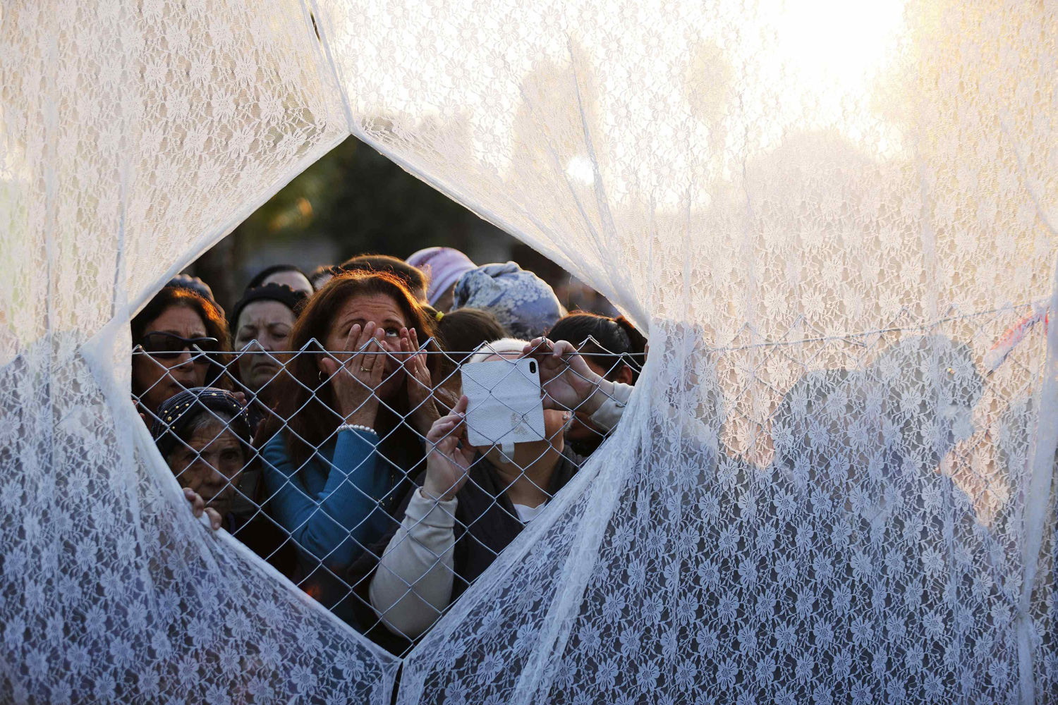 Jan. 5, 2014. Jewish worshippers pray behind a curtain at the gravesite of Rabbi Yisrael Abuhatzeira, a Moroccan-born sage and kabbalist also known as the Baba Sali, during an annual pilgrimage held on the anniversary of his death in the southern Israeli town of Netivot.