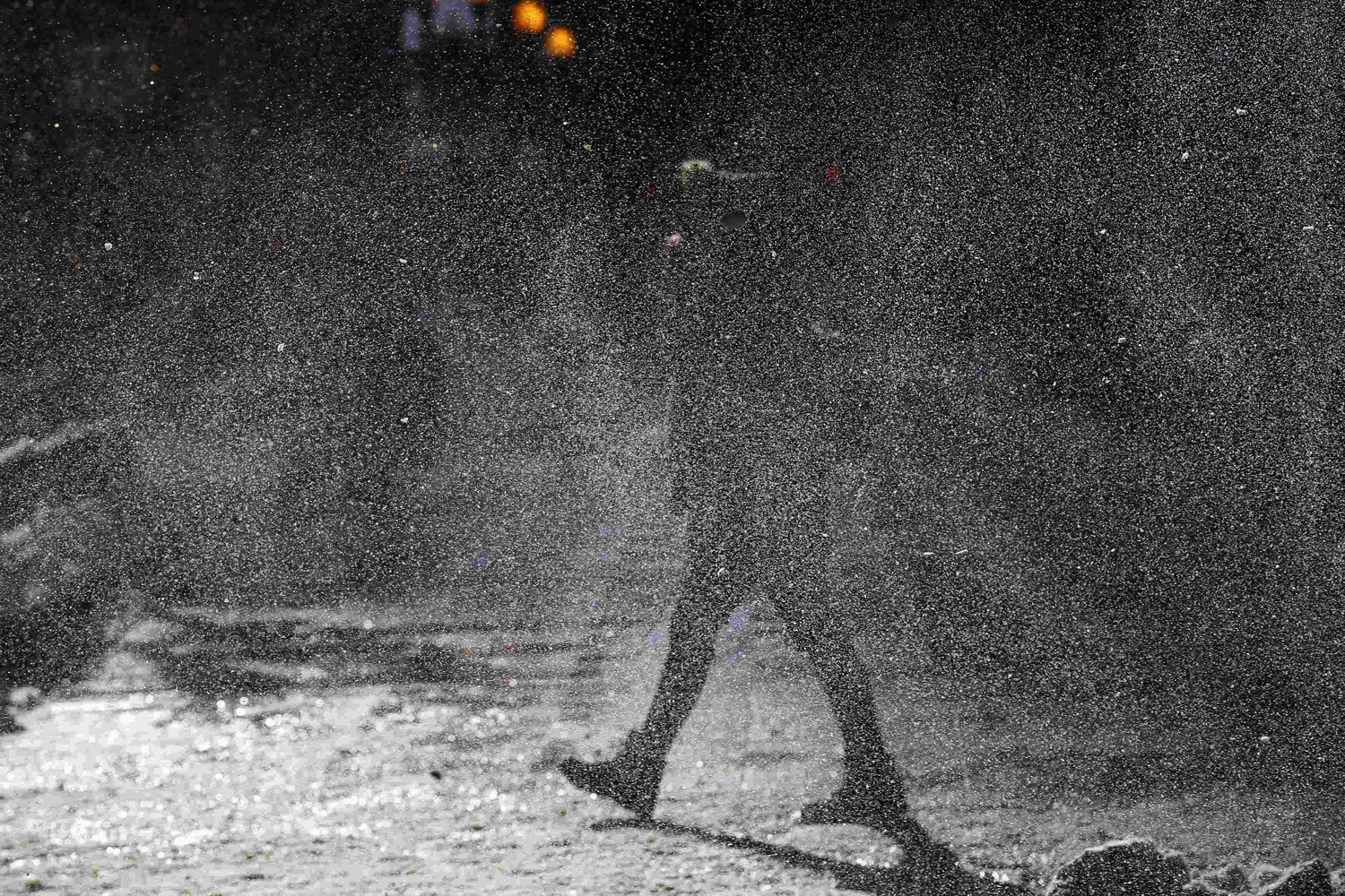 Jan. 6, 2014. A woman walks through a gust of blowing snow in frigid cold temperatures though downtown Chicago.