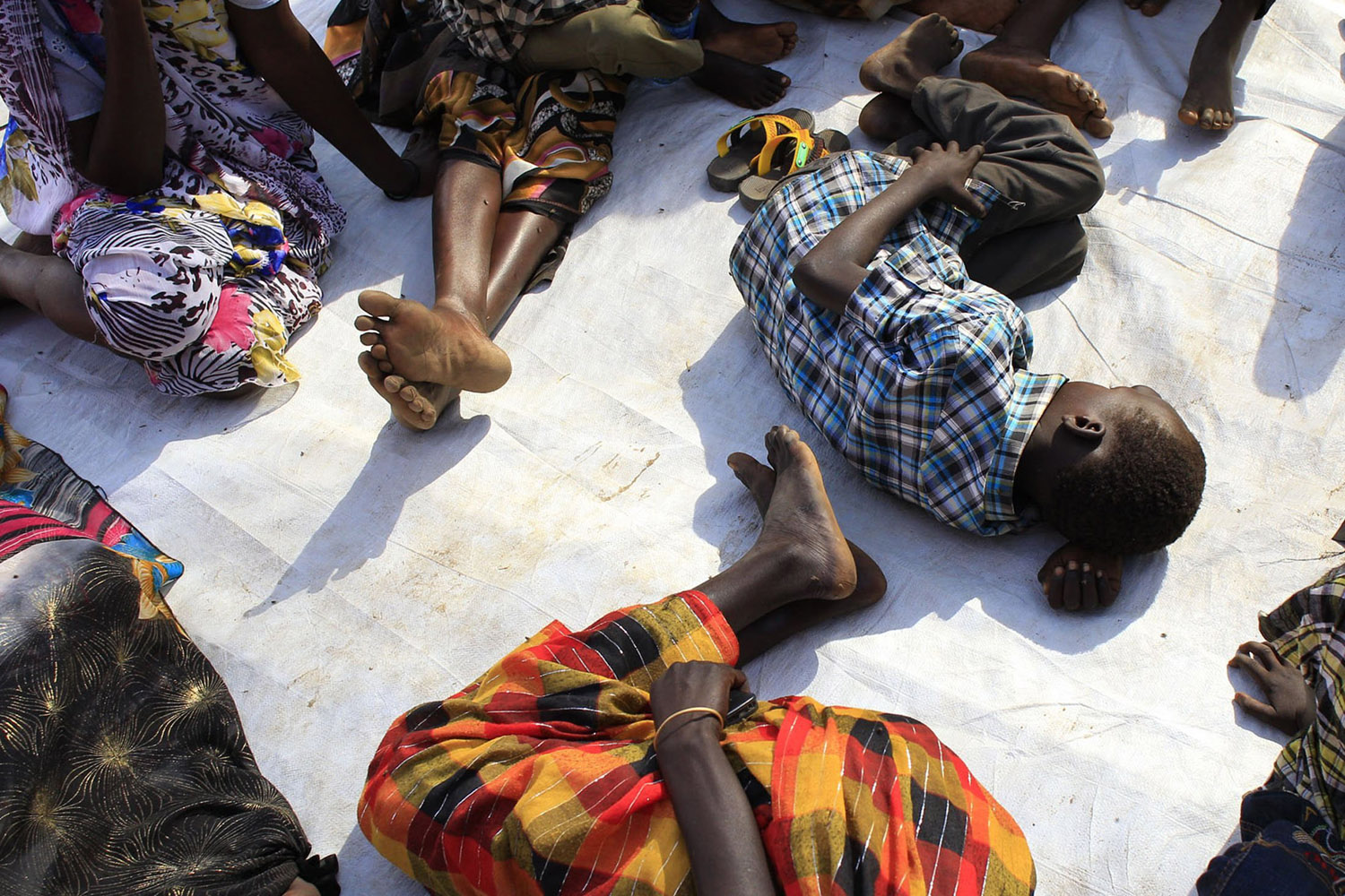 Jan. 7, 2014. Displaced people rest on the floor as they wait for medical attention at an emergency clinic run by Medecins Sans Frontieres (MSN) at Tomping camp in Juba, where some 15,000 displaced people who fled their homes are sheltered by the United Nations.
