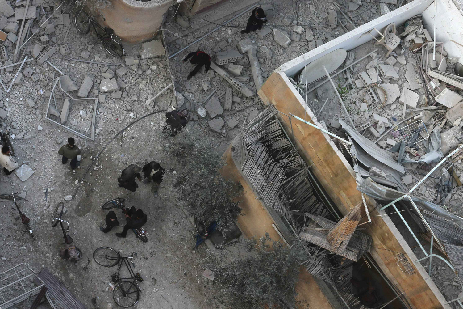 Jan. 7, 2014. People inspect a site hit by what activists said was an airstrike by forces loyal to Syrian President Bashar al-Assad in the Duma neighborhood of Damascus.