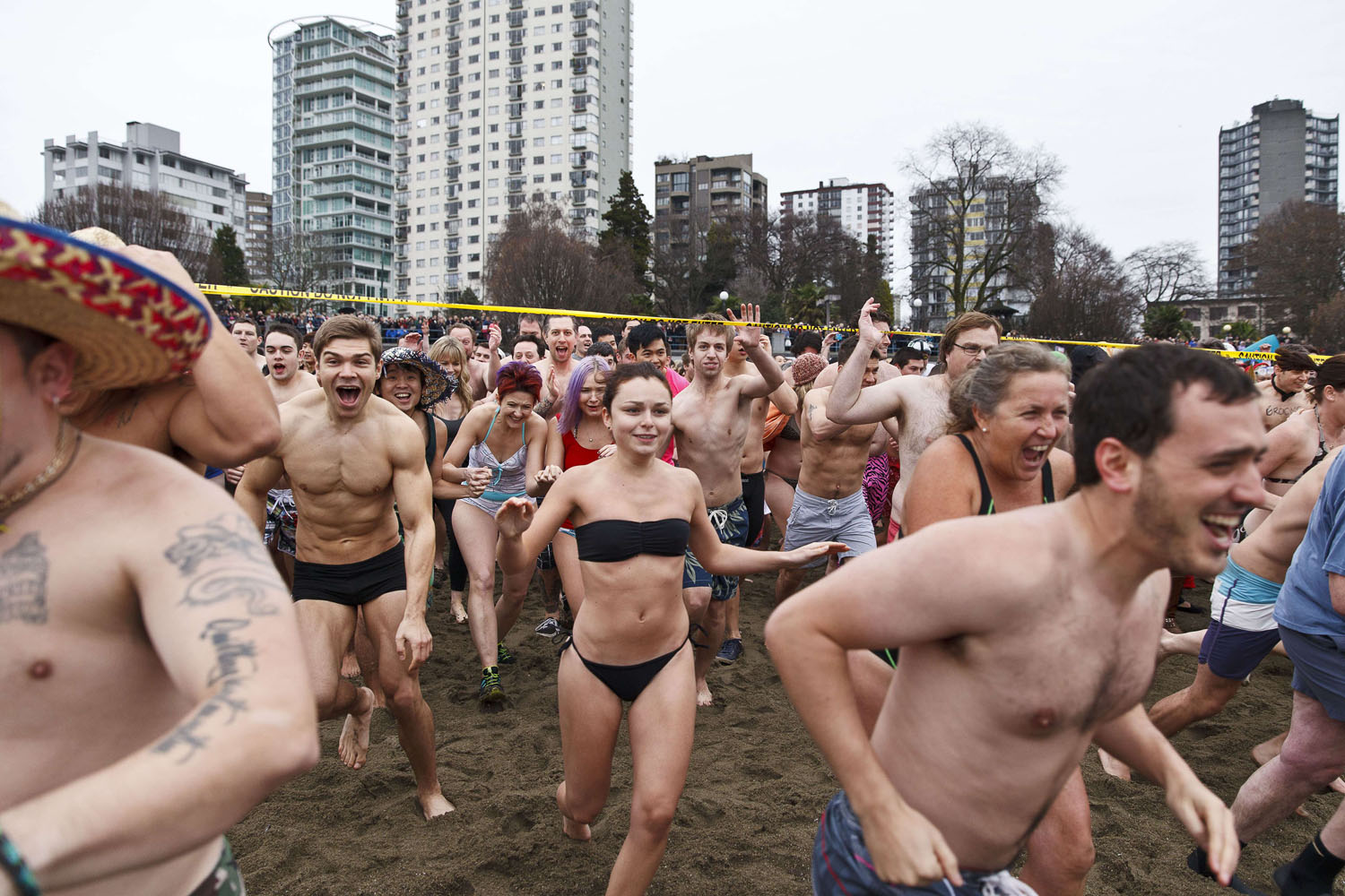 Jan. 1, 2014 Crowds rush towards the frigid waters of English Bay during the 2014 Polar Bear Swim in Vancouver, B.C., Canada.