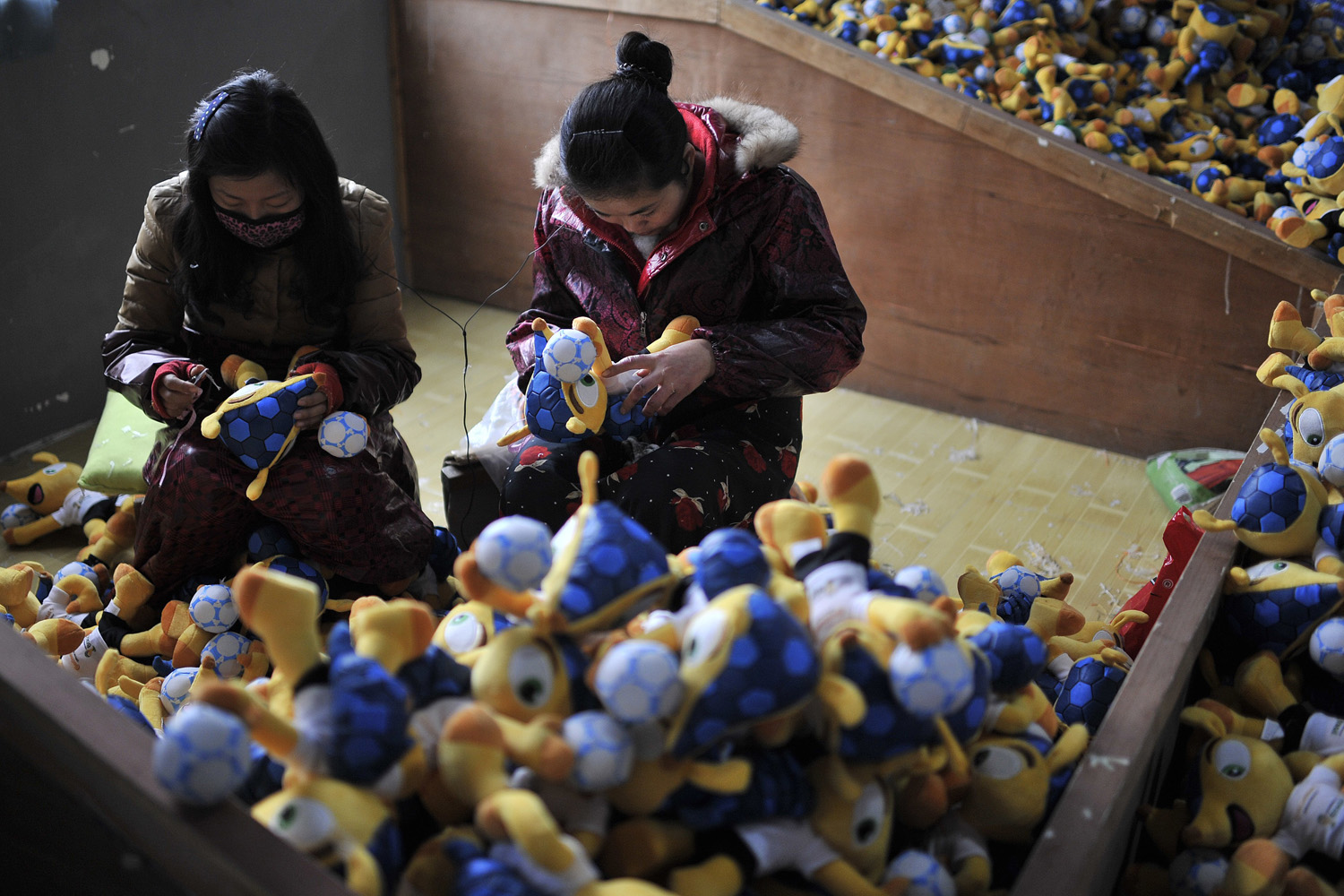 Jan. 6, 2014. Staff work in a factory making toys of the mascot for the 2014 Brazil World Cup  Fuleco  in Tianchang, China.