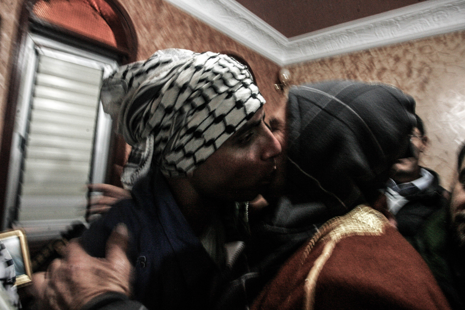 Dec. 31, 2013. Rami Barbakh, a released Palestinian prisoner, (C), is reunited with his family upon arriving at his home in Khan Younis in the southern Gaza Strip.