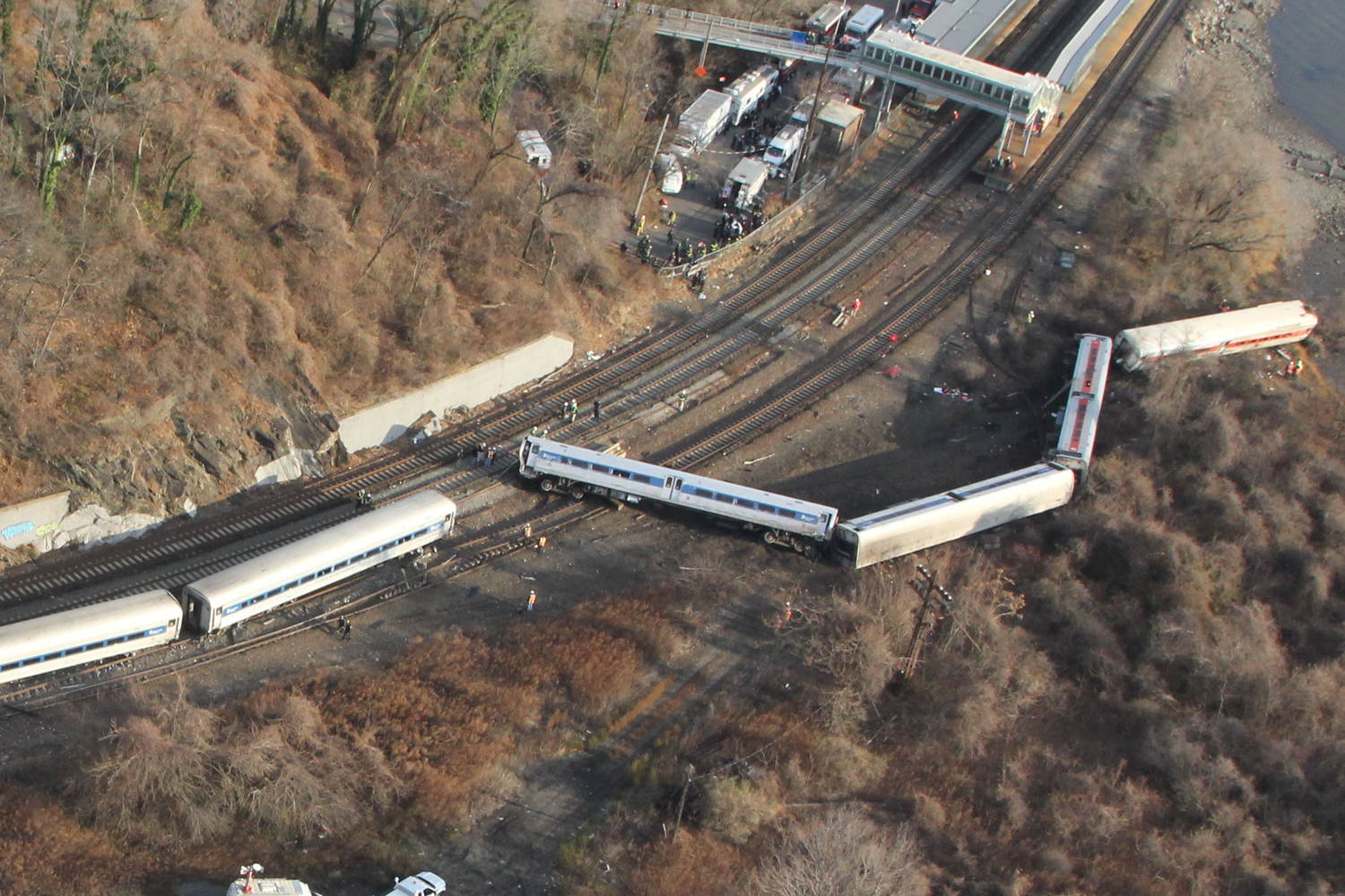 Dec. 1, 2013. In this handout photo provided by the National Transportation Safety Board (NTSB), a Metro North train sits derailed  in the Bronx borough of New York City. Multiple injuries and four deaths were reported after the seven car train left the tracks as it was heading to Grand Central Terminal along the Hudson River line.  (Photo by NTSB via Getty Images)