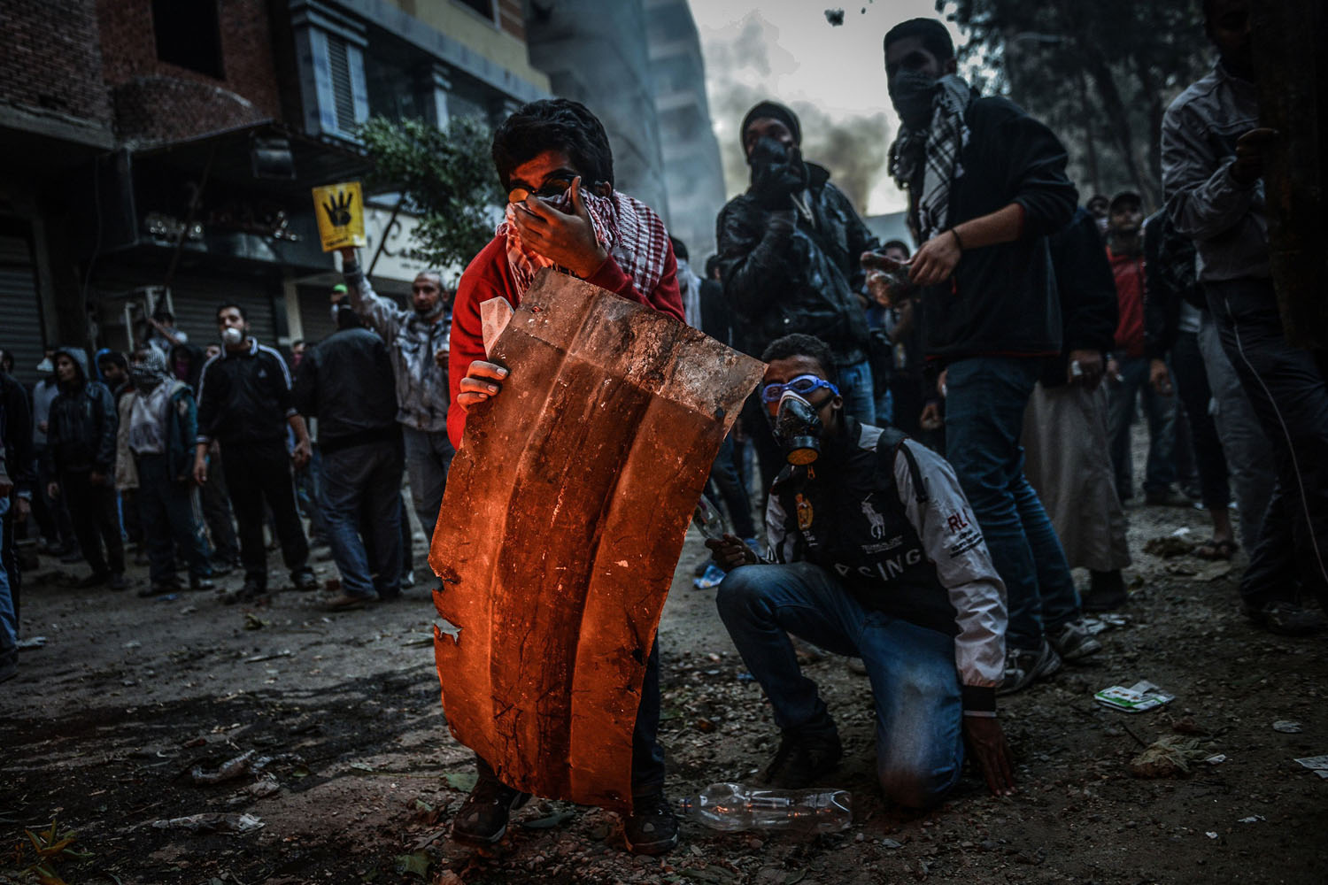 Dec. 27, 2013. Egyptian pro-democracy protestors and police clash during a demonstration against Muslim Brotherhood's 'terrorist label' in the Alf Maskan district of Cairo, Egypt.