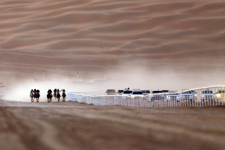 Jan. 2, 2014. Jockeys compete in a race for purebred Arab horses during the Liwa 2014 Moreeb Dune Festival  in the Liwa desert, 250 kilometres west of the Gulf emirate of Abu Dhabi.