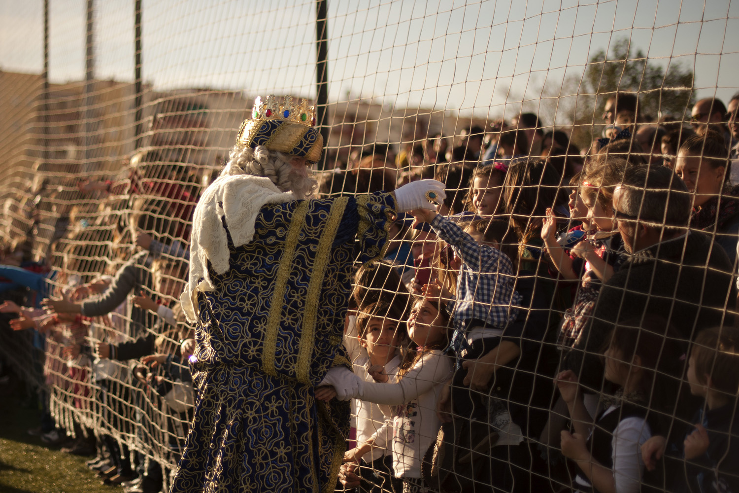 Jan. 5, 2014. A man dressed as King Melchior meets children upon his arrival with men dressed as Kings Balthazar and Caspar, otherwise known as the three wise men or Kings, in Fuengirola, southern Spain, during an Epiphany street parade.
