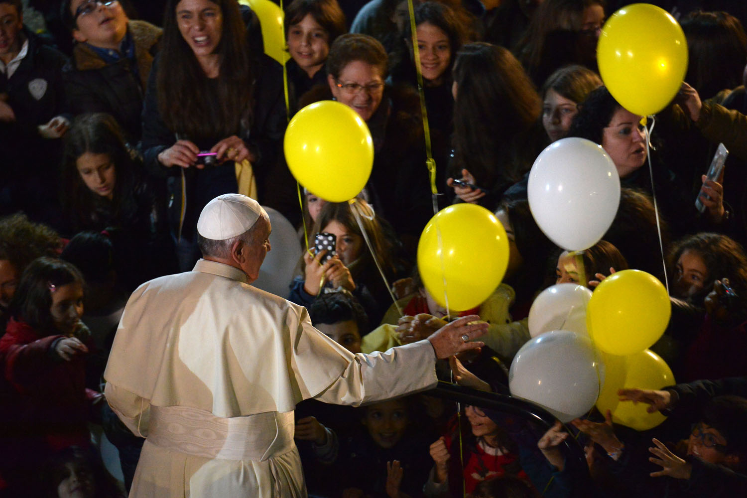 Jan. 6, 2014. Pope Francis waves to children as he visits the parish of the Sant'Alfonso Maria de Liguori during the Epiphany celebrations in Rome.