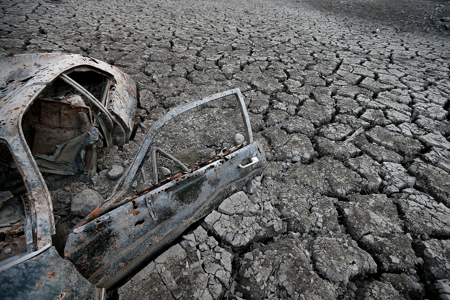 Jan. 28, 2014.  A car sits in dried and cracked earth of what was the bottom of the Almaden Reservoir in San Jose, California.