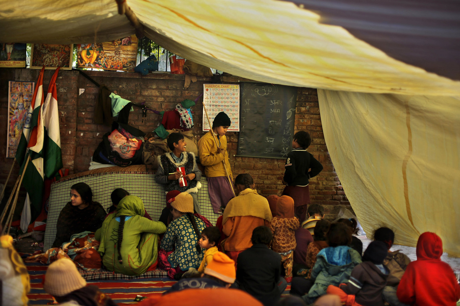 Jan. 7, 2014. Pakistani Hindu children study under a makeshift tent where they are staging a protest to demand permanent residency in New Delhi, India.