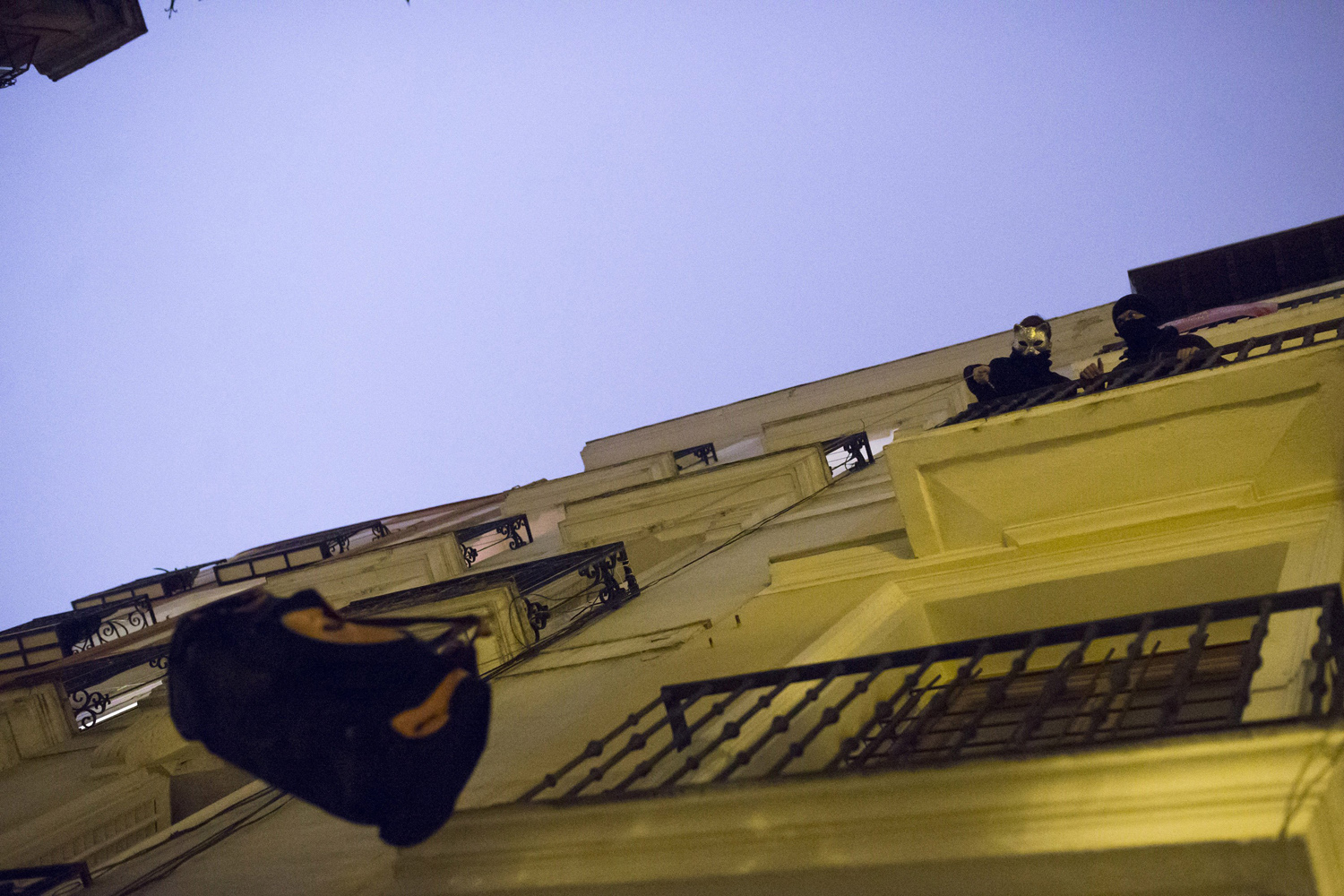 Jan. 5, 2014. Activists handle belongings after occupying an empty building in Madrid.