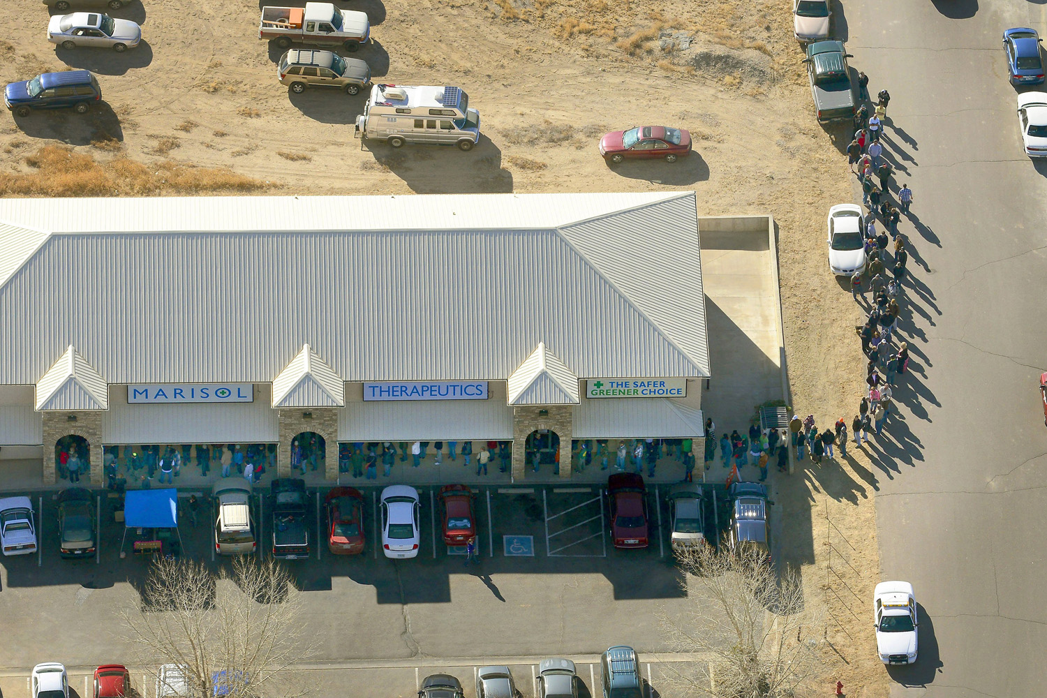 Jan. 1, 2014. A long line of buyers trails from a store selling marijuana in Pueblo West, Colo.