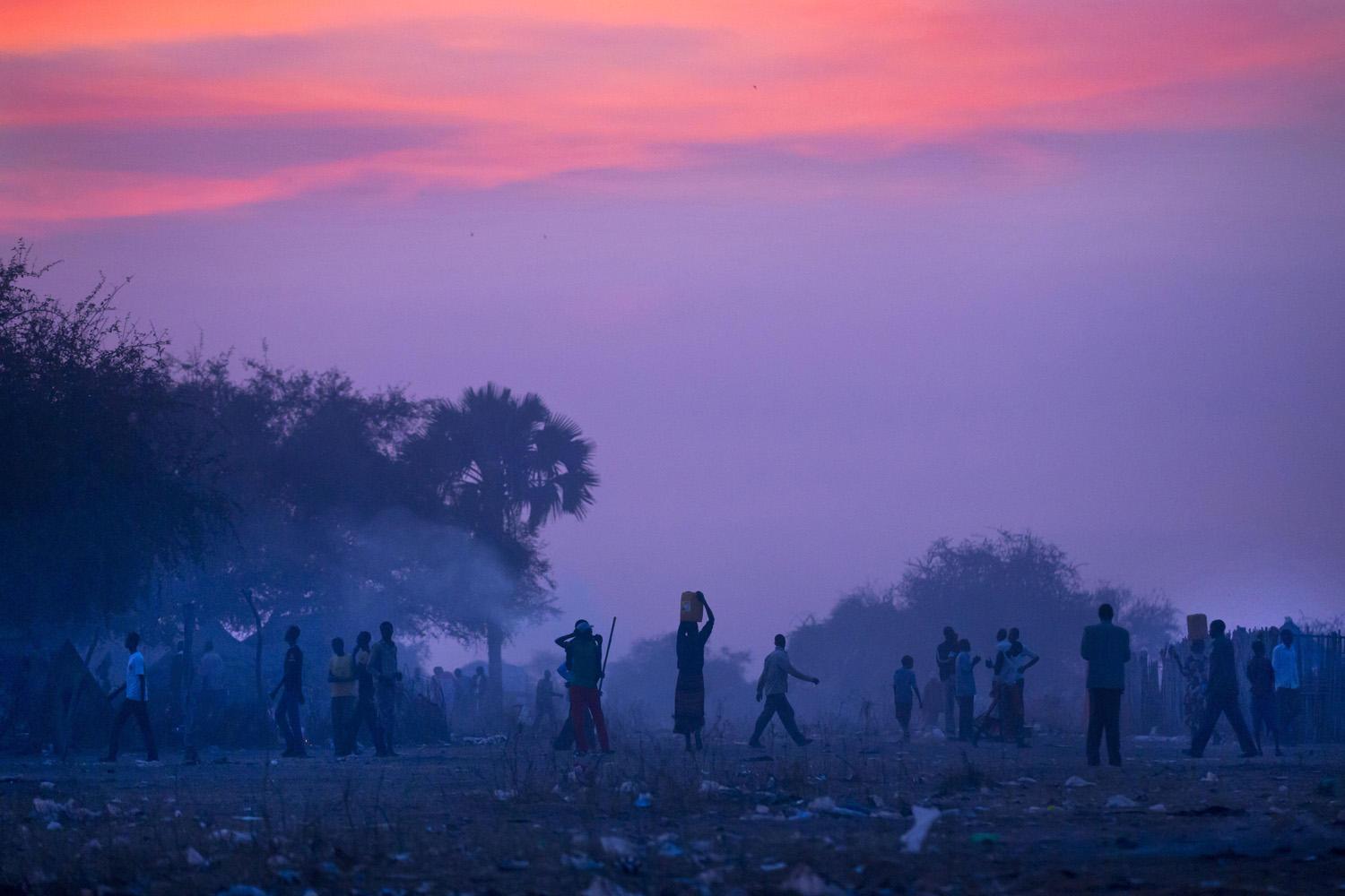 Jan. 1, 2014. Displaced people who fled the recent fighting between government and rebel forces in Bor, prepare to sleep in the open at night in the town of Awerial, South Sudan.