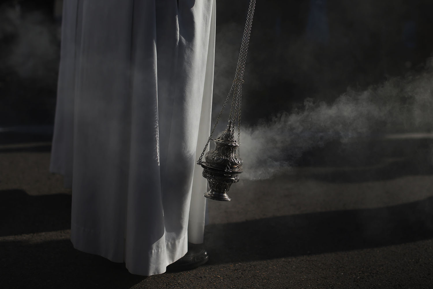 Dec. 29, 2013. A member of the church shakes a censer during a mass honoring the family in Madrid, Spain.
