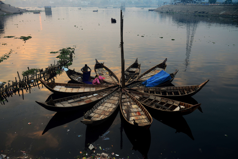 Jan. 3, 2014. A Bangladeshi boatman tidies up his bedding after waking up in the early morning in Dhaka, Bangladesh.