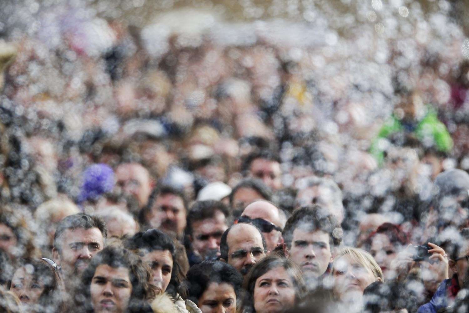 Dec. 29, 2013. Faithful are pictured through the water of a fountain as Pope Francis leads the Angelus prayer from the window of the Apostolic palace in Saint Peter's Square at the Vatican, Italy.